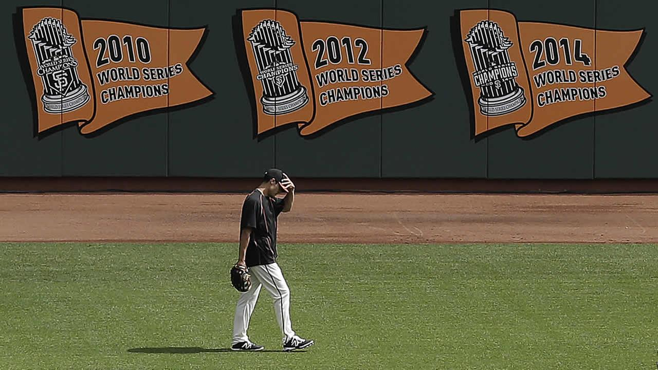 San Francisco Giants championships are displayed on a wall at AT&T Park before a baseball game between the Giants and the Colorado Rockies in San Francisco, April 13, 2015. (AP Photo/Jeff Chiu)AP Photo/Jeff Chiu