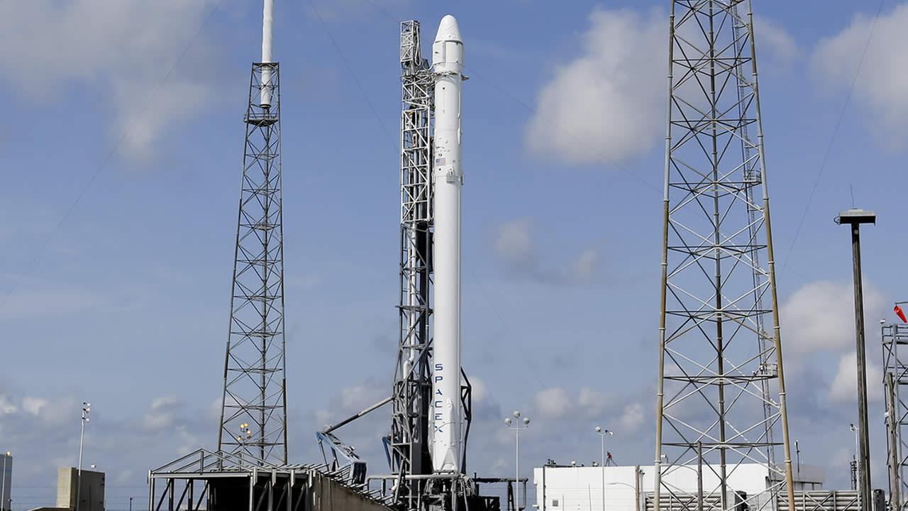 The Falcon 9 SpaceX rocket stands ready for launch at Complex 40 at the Cape Canaveral Air Force Station in Cape Canaveral, Fla., Monday, April 13, 2015. (AP Photo/John Raoux)