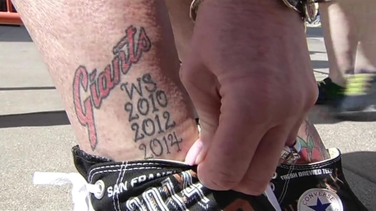 A fan shows off her tattoo with the years the San Francisco Giants won the World Series at the teams home opener at AT&T Park on April 13, 2015.KGO-TV