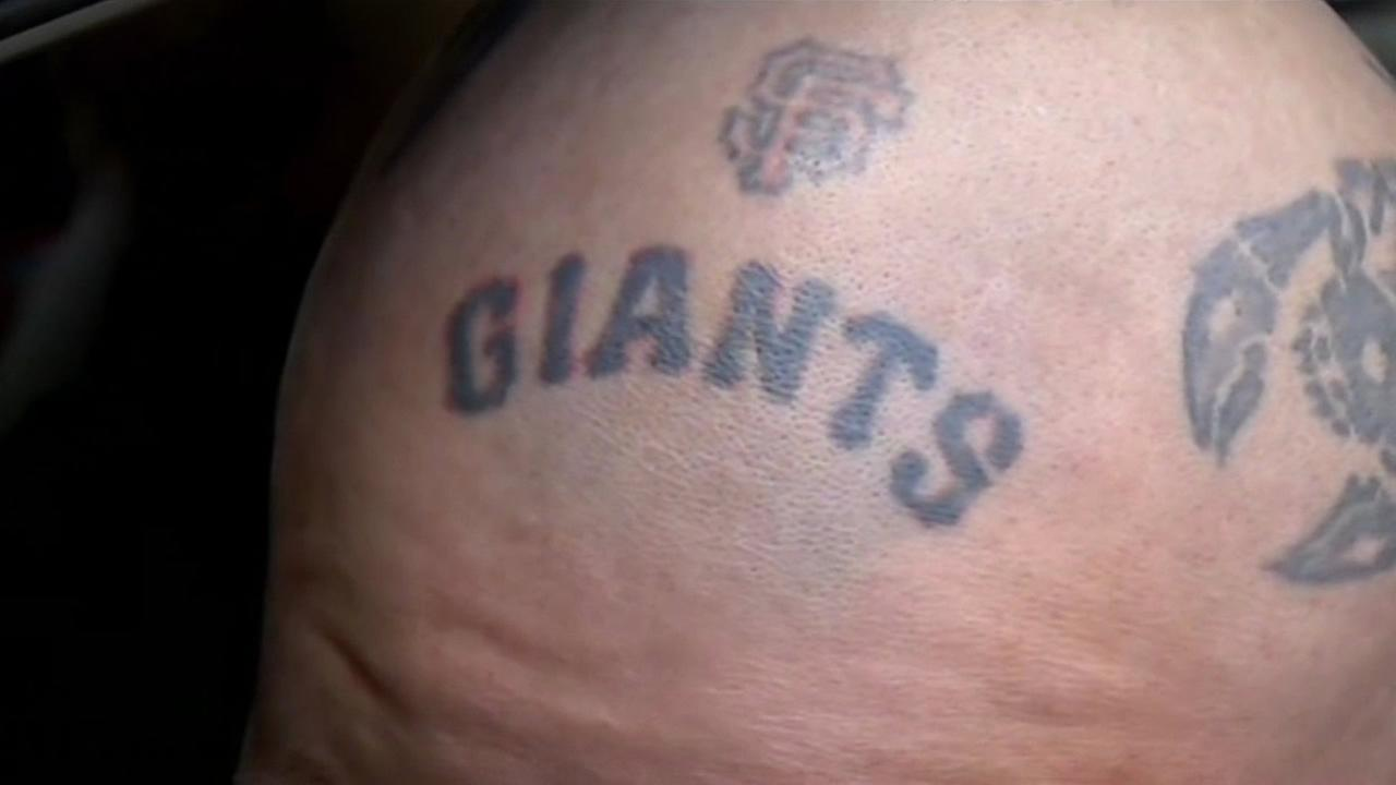 A fan shows off his tattoo with the San Francisco Giants logo at the teams home opener at AT&T Park on April 13, 2015.KGO-TV