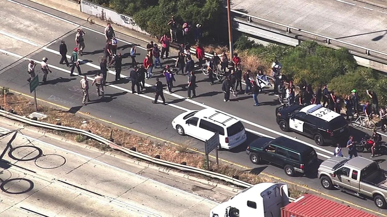 Demonstrators protesting police killings across the country briefly march onto I-880 in Oakland on April 14, 2015.