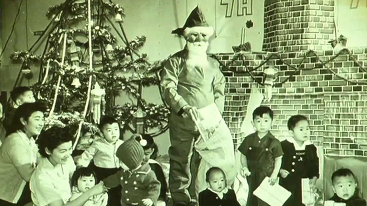 This undated image shows a Christmas celebration at a World War II internment camp.