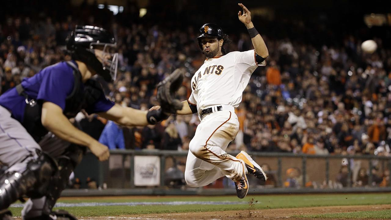 San Francisco Giants Angel Pagan leaps into the air