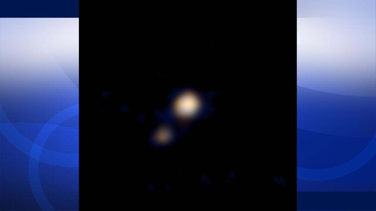 NASAs New Horizons spacecraft captured the first color image of Pluto and its largest moon on April 9, 2015.