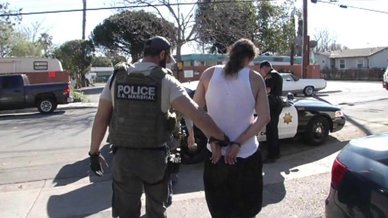 A man was arrested in Oakland, Calif. in April 2015 following a nationwide sweep of violent felons by U.S. Marshals and state and local law enforcement agencies.