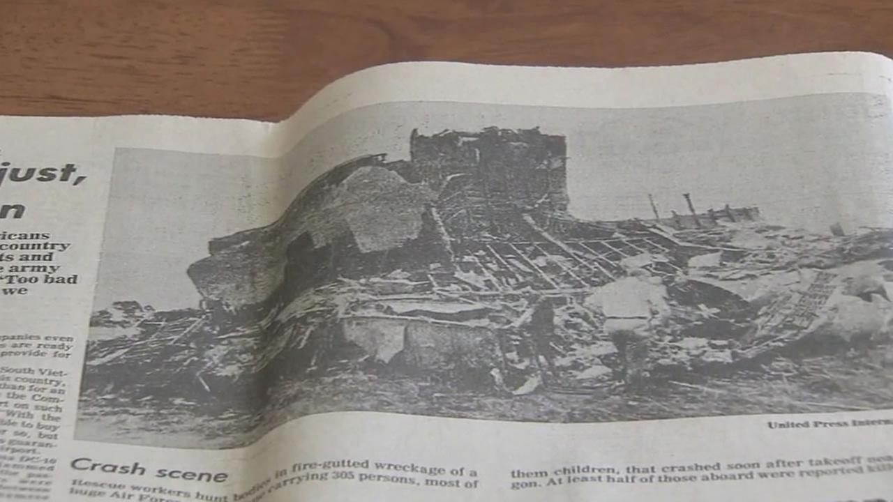 This undated image shows a newspaper showing the April 4, 1975 plane crash scene from the first Operation Babylift mission.