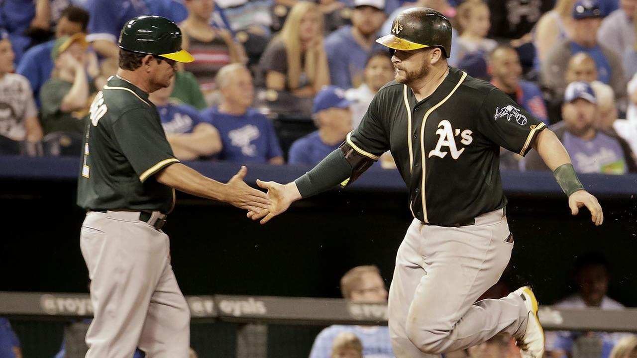 Oakland Athletics Stephen Vogt, right, celebrates with third base coach Mike Gallego