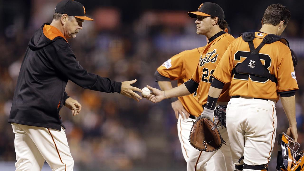 Bruce Bochy takes the ball from pitcher Jake Peavy