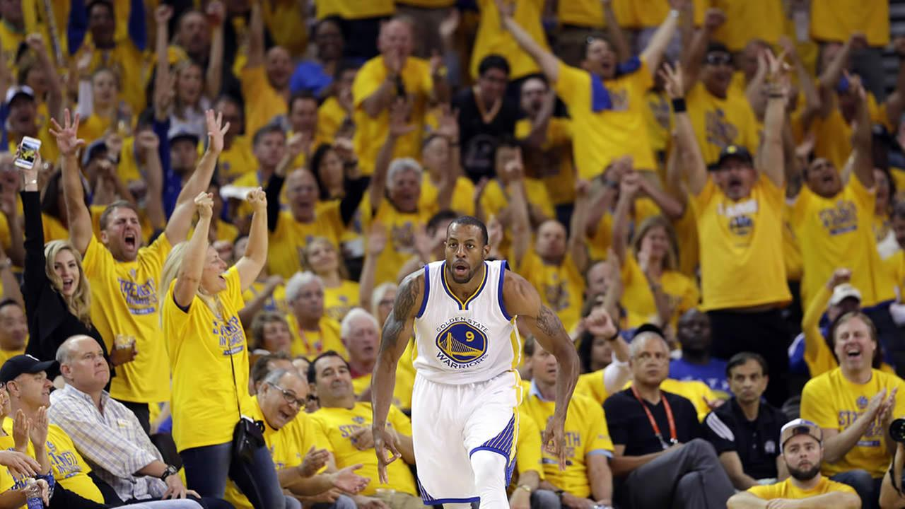 The crowd celebrates after a 3-point basket by Warriors Andre Iguodala (9) during Game 1 of the NBA basketball playoffs on April 18, 2015, in Oakland, Calif. (AP Photo)