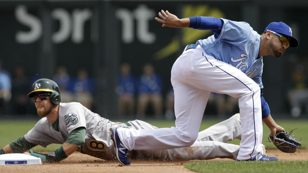 Athletics Ben Zobrist steals second base while Royals Omar Infante fields a throw during a baseball game at Kauffman Stadium in Kansas City, Mo. on April 19, 2015. (AP Photo)