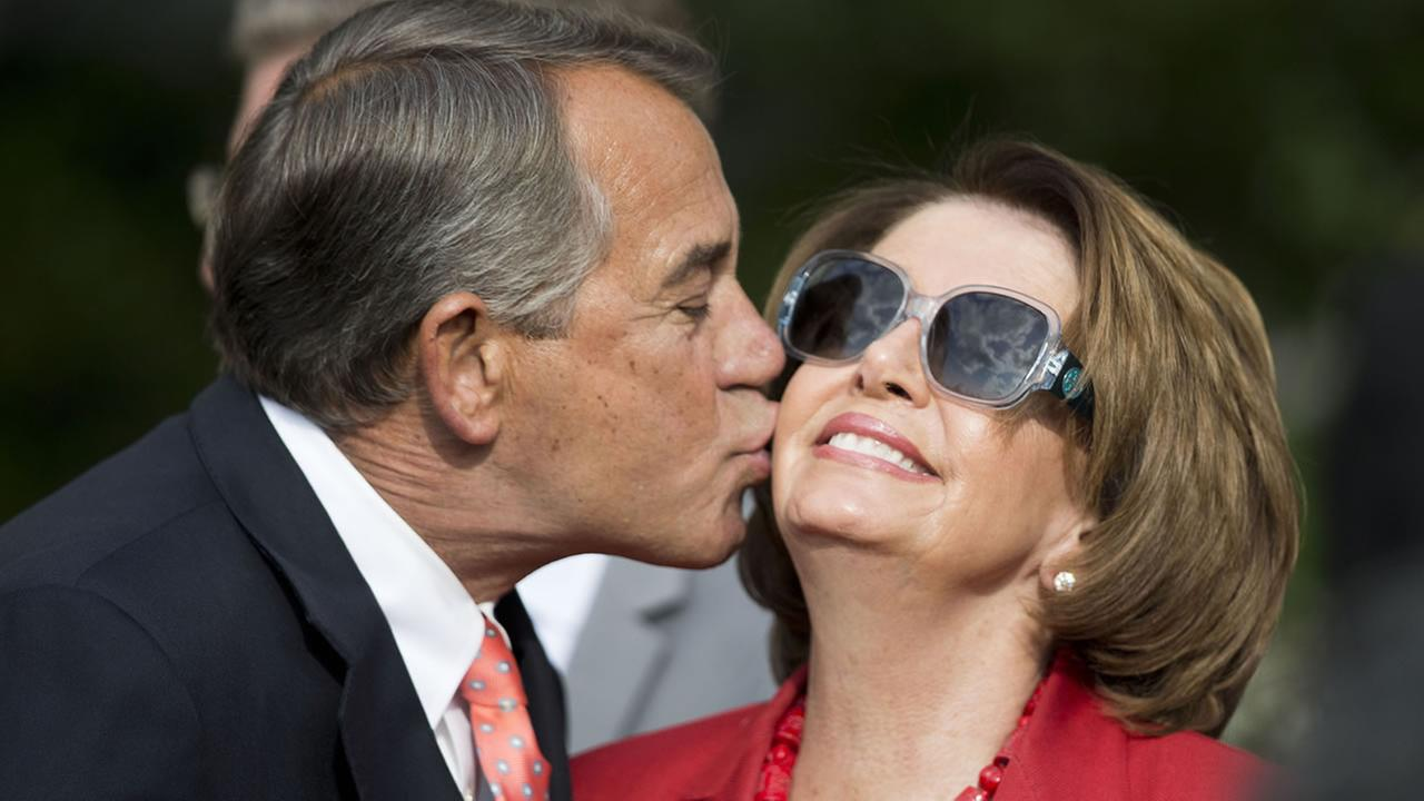 House Speaker John Boehner of Ohio kisses House Minority Leader Nancy Pelosi of Calif. in the Rose Garden of the White House, April 21, 2015 in Washington.