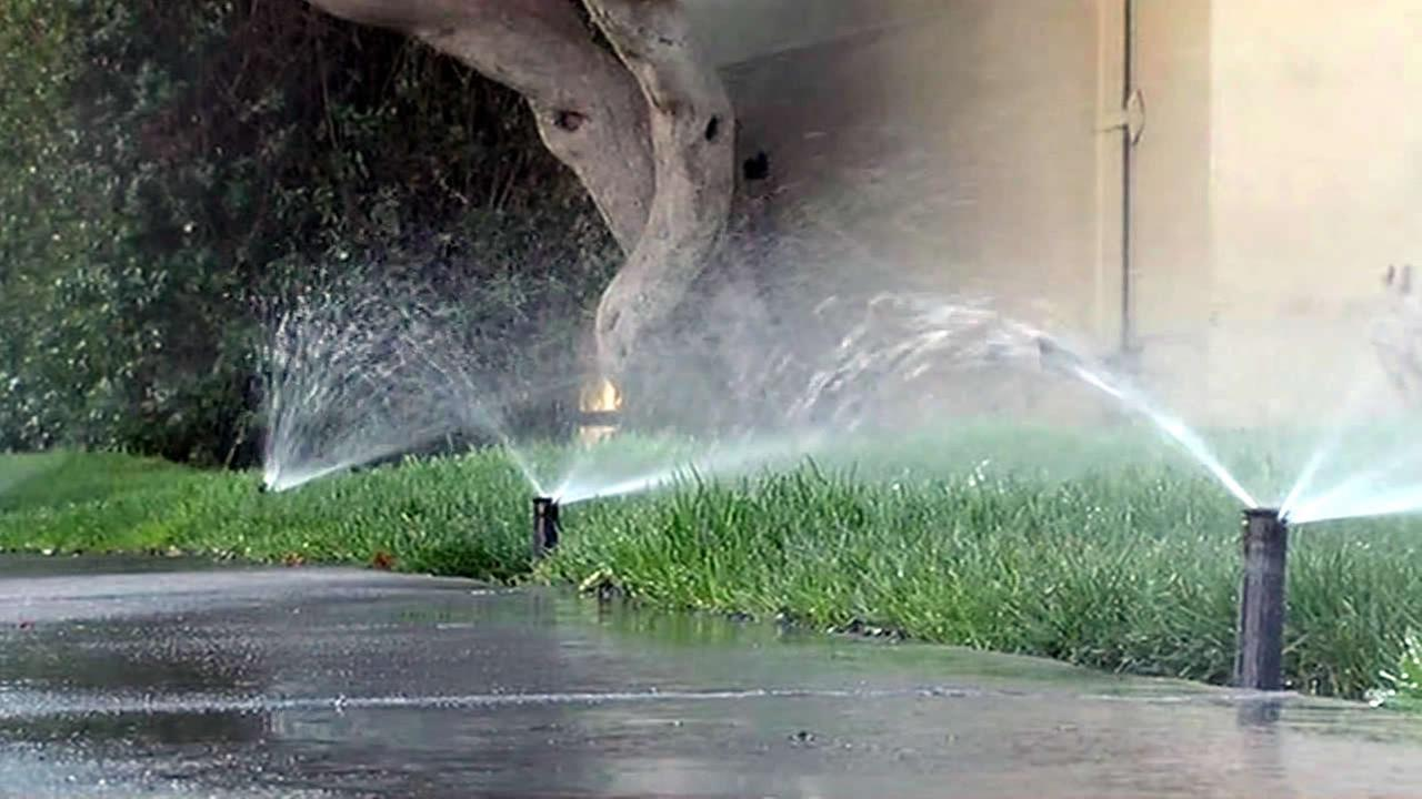 In this undated image, sprinklers water a lawn in San Jose, Calif.
