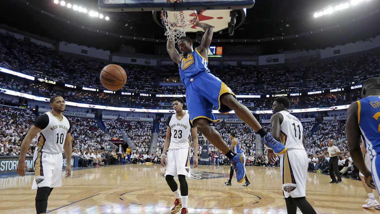 Warriors forward Harrison Barnes (40) slam-dunks over Pelicans guard Eric Gordon during Game 4 of the NBA Playoffs in New Orleans on April 25, 2015. (AP Photo/Gerald Herbert)