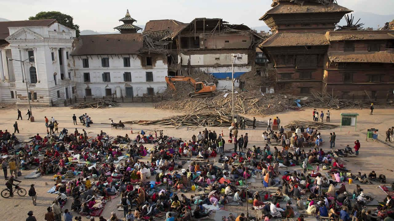 People gather on an open space for security reasons at the Basantapur Durbar Square, damaged in Saturdays earthquake in Kathmandu, Nepal, Sunday, April 26, 2015. (AP Photo/Bernat Armangue)