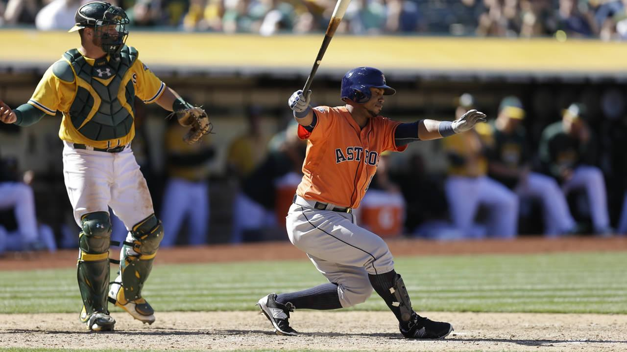 Houston Astros Luis Valbuena swings against the Oakland Athletics during a baseball game Sunday, April 26, 2015, in Oakland, Calif. (AP Photo/Ben Margot)