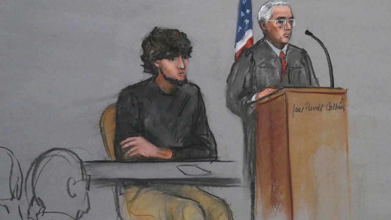 FILE - In this Monday, Jan. 5, 2015, file courtroom sketch, Boston Marathon bombing suspect Dzhokhar Tsarnaev is depicted beside U.S. District Judge George OToole Jr., in Boston.  (AP Photo/Jane Flavell Collins, File)