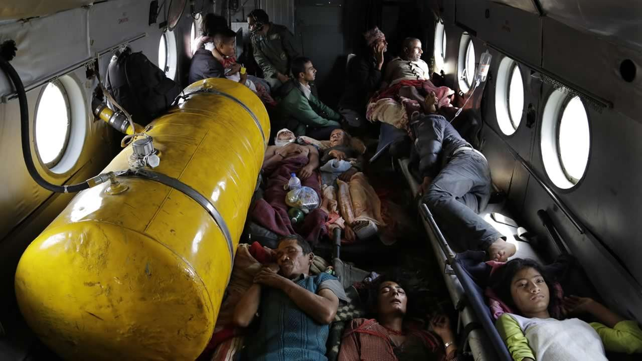 Nepalese victims of Saturdays earthquake lie inside a helicopter as they are evacuated from Trishuli Bazar to Kathmandu airport in Nepal, April 27, 2015. (AP Photo/Altaf Qadri)