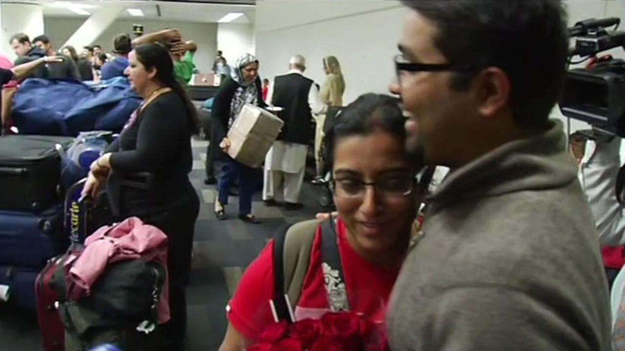 Husband and wife Taran and Ranjanee Rao hug at San Francisco International Airport on April 28, 2015.