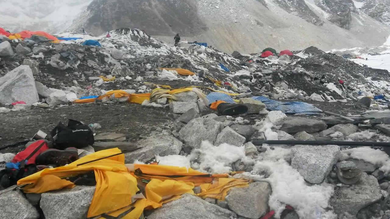 Shoes and camping gear lie strewn about after an avalanche hit the area on Saturday at Everest Base Camp, Nepal, Tuesday, April 28, 2015. (AP Photo/Nima Namgyal Sherpa)
