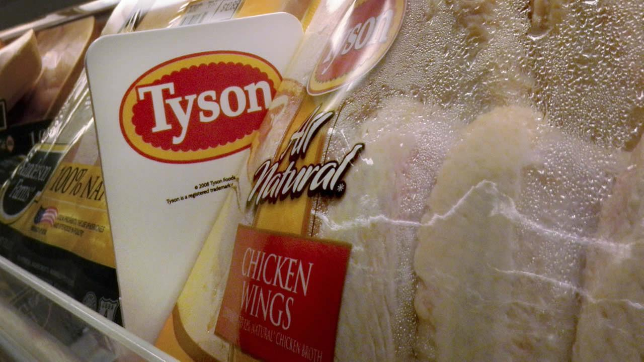FILE - In this May 3, 2009 file photo, Tyson Foods chicken products are displayed on the shelves of a Little Rock, Ark. grocery store. (AP Photo/Danny Johnston)