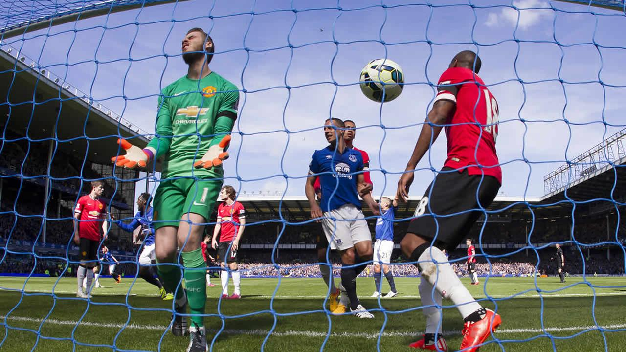 FILE - In this April 26, 2015 file photo Manchester Uniteds goalkeeper David De Gea reacts in frustration after a goal at Goodison Park Stadium, Liverpool, England. (AP Photo)