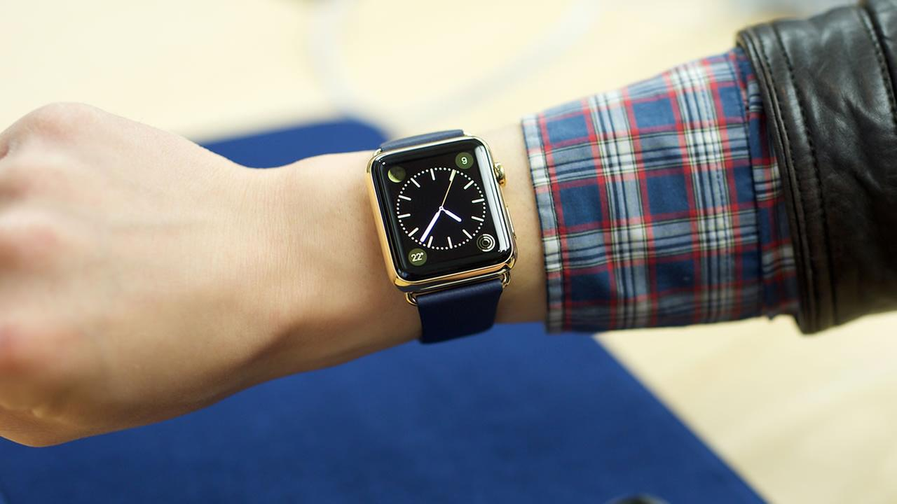 A customer tries on the new Apple Watch Edition on Friday, April 10, 2015.