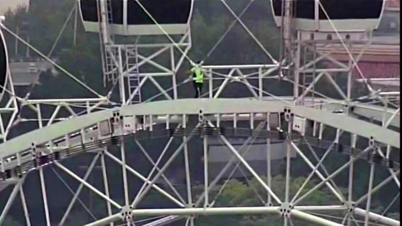 Daredevil Nik Wallenda successfully walked along the top of the 400-foot-high Orlando Eye as it was spinning on Wednesday, April 29, 2015.