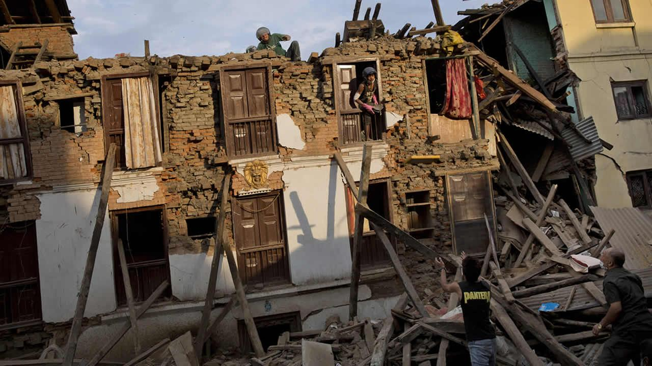 Nepalese villagers salvage items from a house destroyed by Saturdays earthquake in Sakhu, on the outskirts of Kathmandu, Nepal, April 29, 2015. (AP Photo/Bernat Amangue)