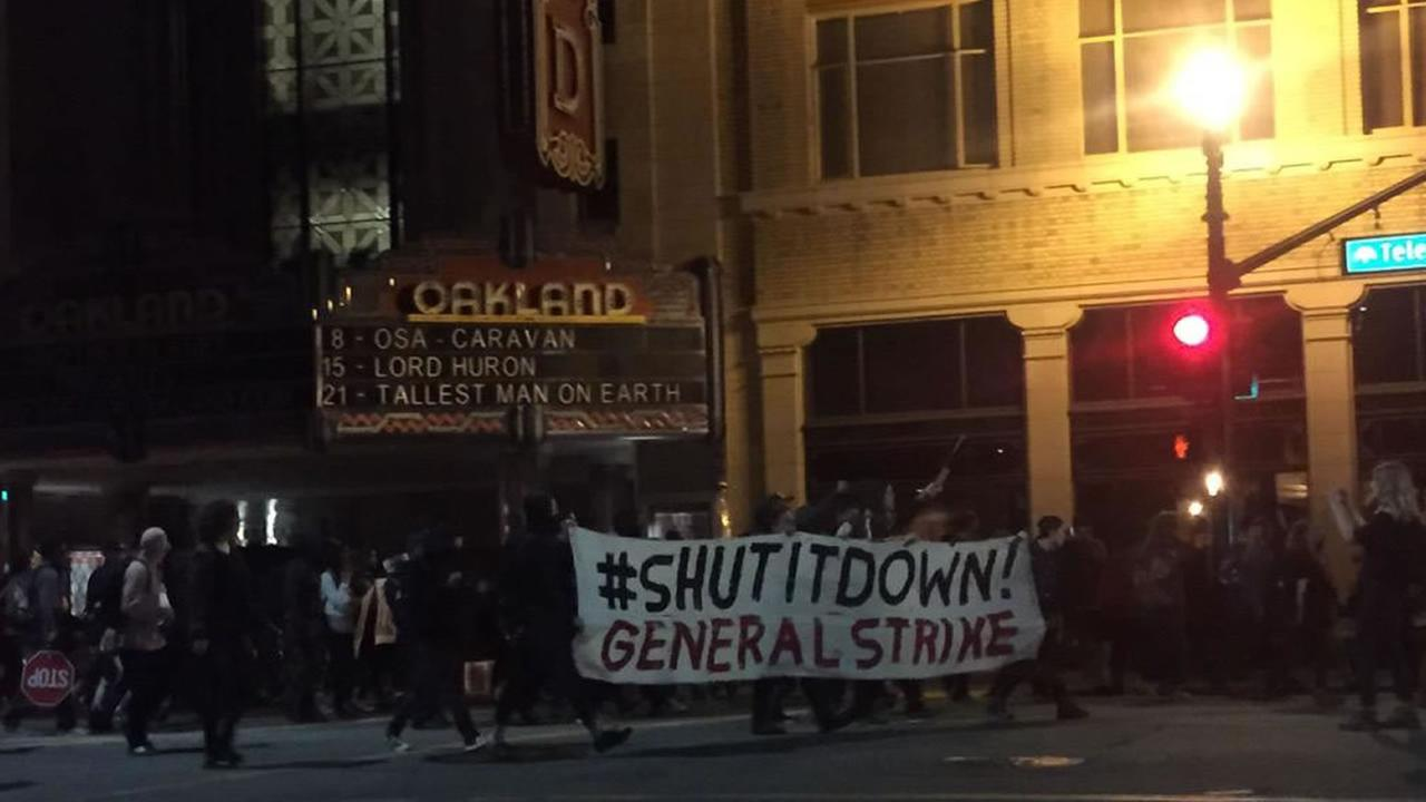 After daylong May Day protests in Oakland, demonstrators took to the streets Friday night and began marching through downtown, May 1, 2015.