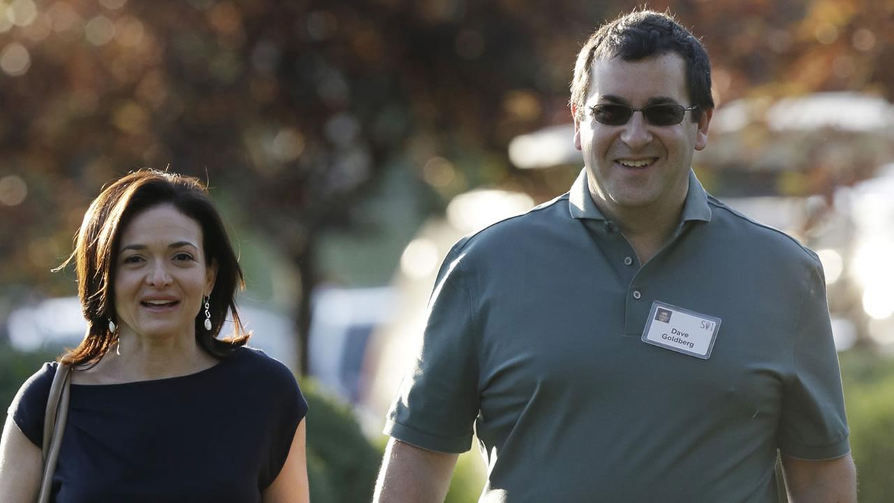 Sheryl Sandberg, COO of Facebook, and her husband David Goldberg in Sun Valley, Idaho, Wednesday, July 10, 2013. AP Photo/Rick Bowmer