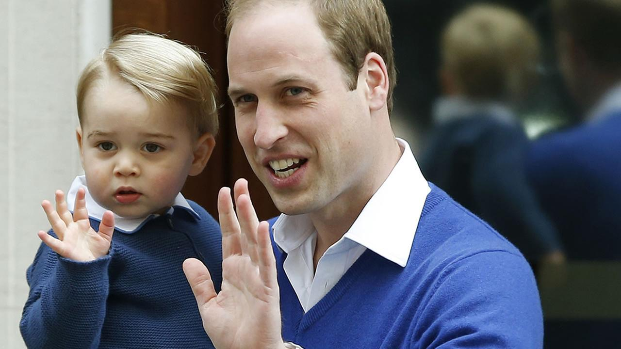 Britains Prince William and his son Prince George wave as they return to St. Marys Hospital in London on Saturday, May 2, 2015.AP Photo/Alastair Grant