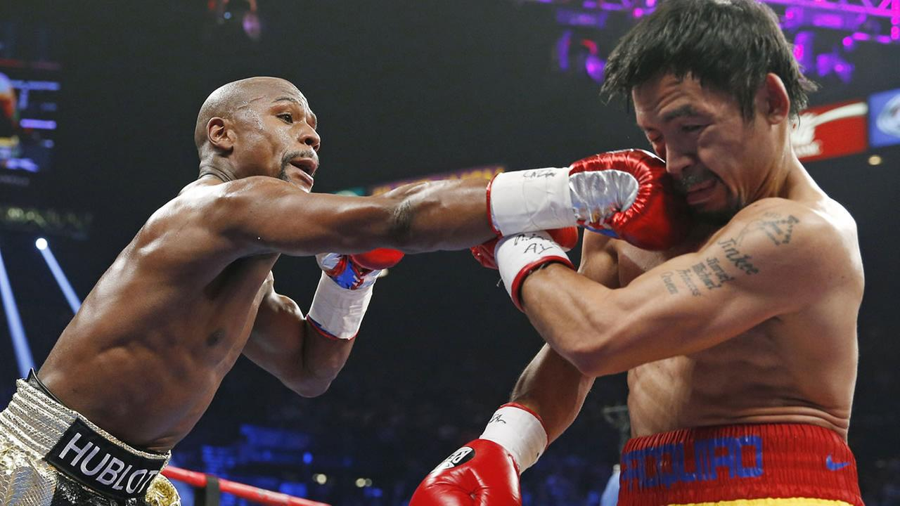 Floyd Mayweather Jr. connects with a right to the head of Manny Pacquiao, from the Philippines, during their welterweight title fight on May 2, 2015 in Las Vegas. (AP Photo)
