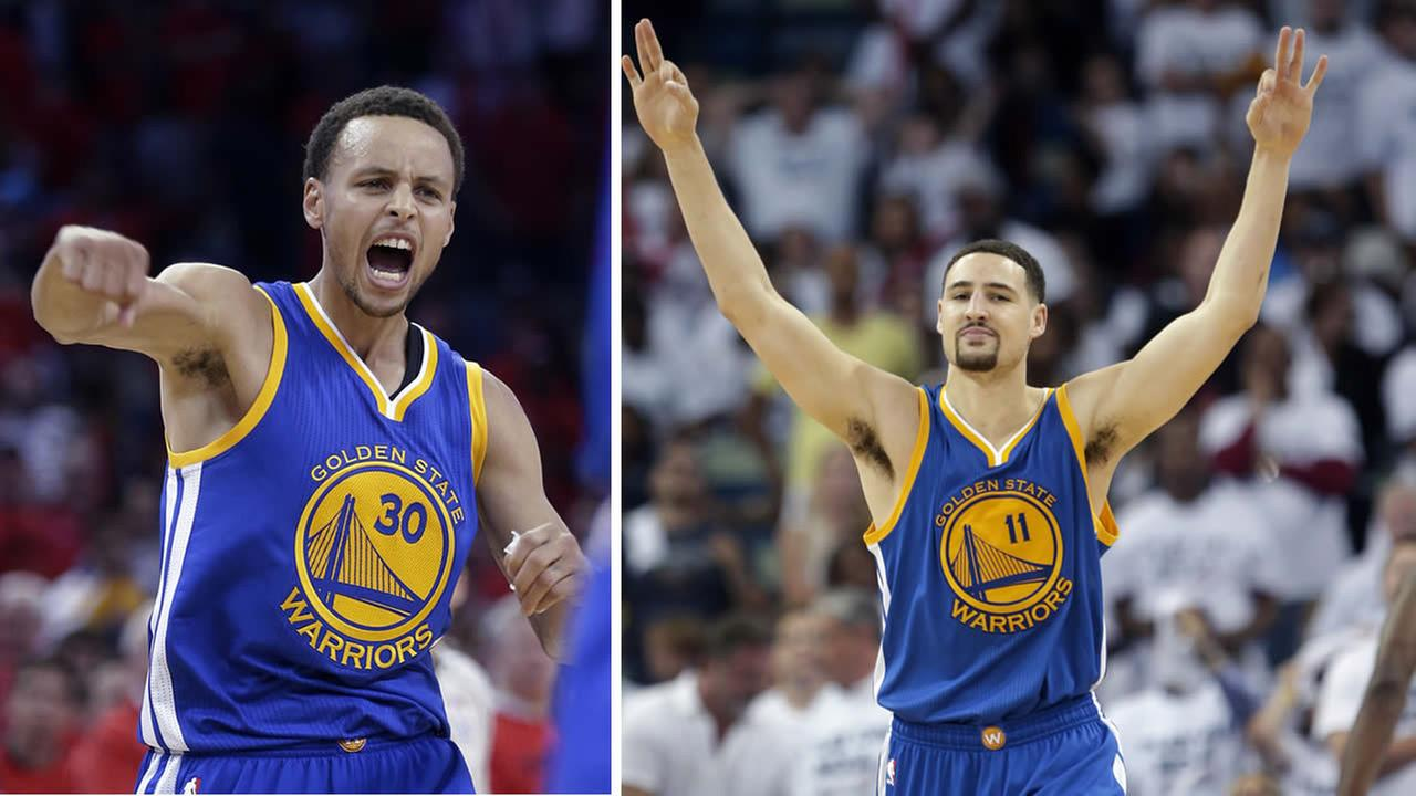 Golden State Warriors guards Steph Curry and Klay Thompson celebrate during an NBA playoff game against the New Orleans Pelicans in April 2015. (AP Photo/Gerald Herbert)