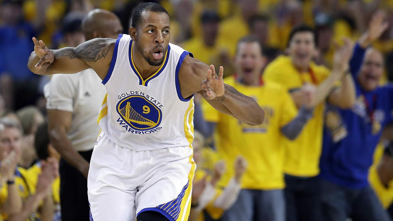 Golden State Warriors forward Andre Iguodala reacts after making a three point basket against the Memphis Grizzlies during a second-round NBA playoff basketball series in Oakland, Calif., May 3, 2015. (AP Photo/Marcio Jose Sanchez)
