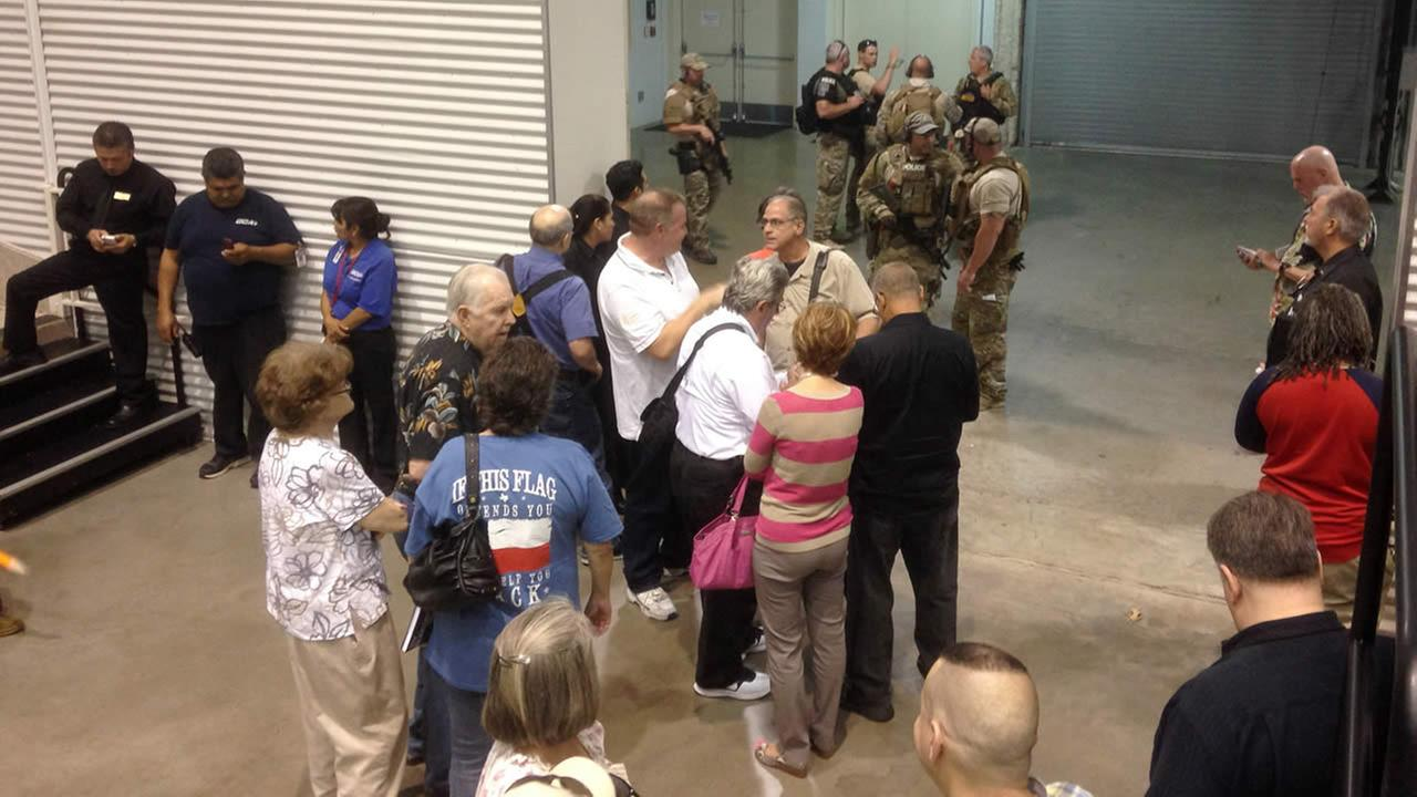 People are sequestered by members of the Garland Police Department inside the Curtis Culwell Center, Sunday, May 3, 2015, in Garland, Texas. (AP Pho