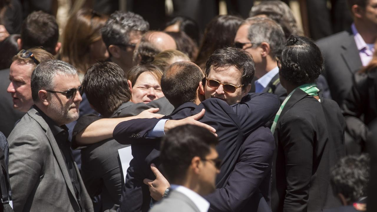 Mourners leave a memorial service for SurveyMonkey CEO David Goldberg