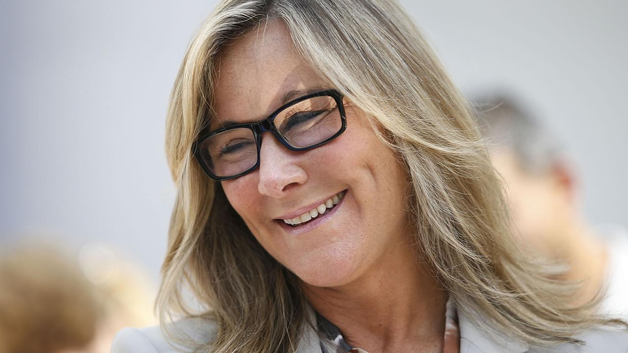 Angela Ahrendts, senior vice president of retail and online stores at Apple Inc., walks through the Apple Store during the launch of the new iPhone 6 on Friday, Sept 19, 2014.