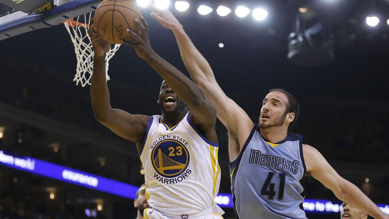 Golden State Warriors forward Draymond Green (23) grabs a rebound in front of Memphis Grizzlies center Kosta Koufos (41) during the first half of Game 2, May 5, 2015.
