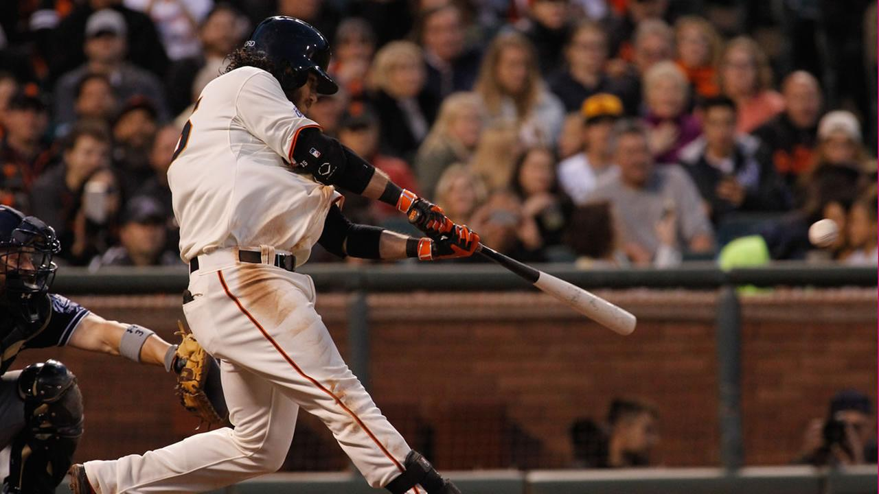 San Francisco Giants Brandon Crawford hits an RBI double in the third inning of a baseball game against the San Diego Padres, Tuesday, May 5, 2015, in San Francisco.