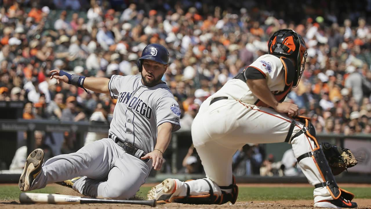 San Diego Padres Yonder Alonso scores as San Francisco Giants catcher Andrew Susac waits for the throw in the eighth inning on Wednesday, May 6, 2015, in San Francisco.
