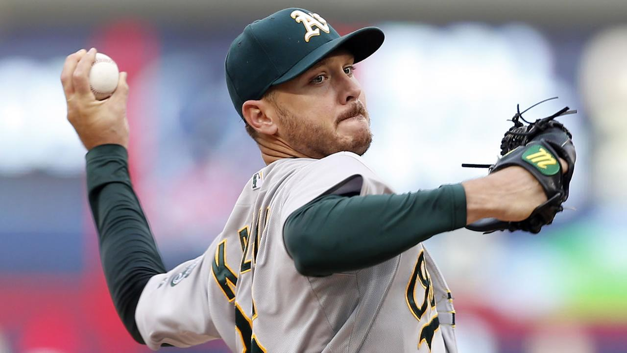 Oakland Athletics pitcher Scott Kazmir throws against the Minnesota Twins in the first inning of a baseball game