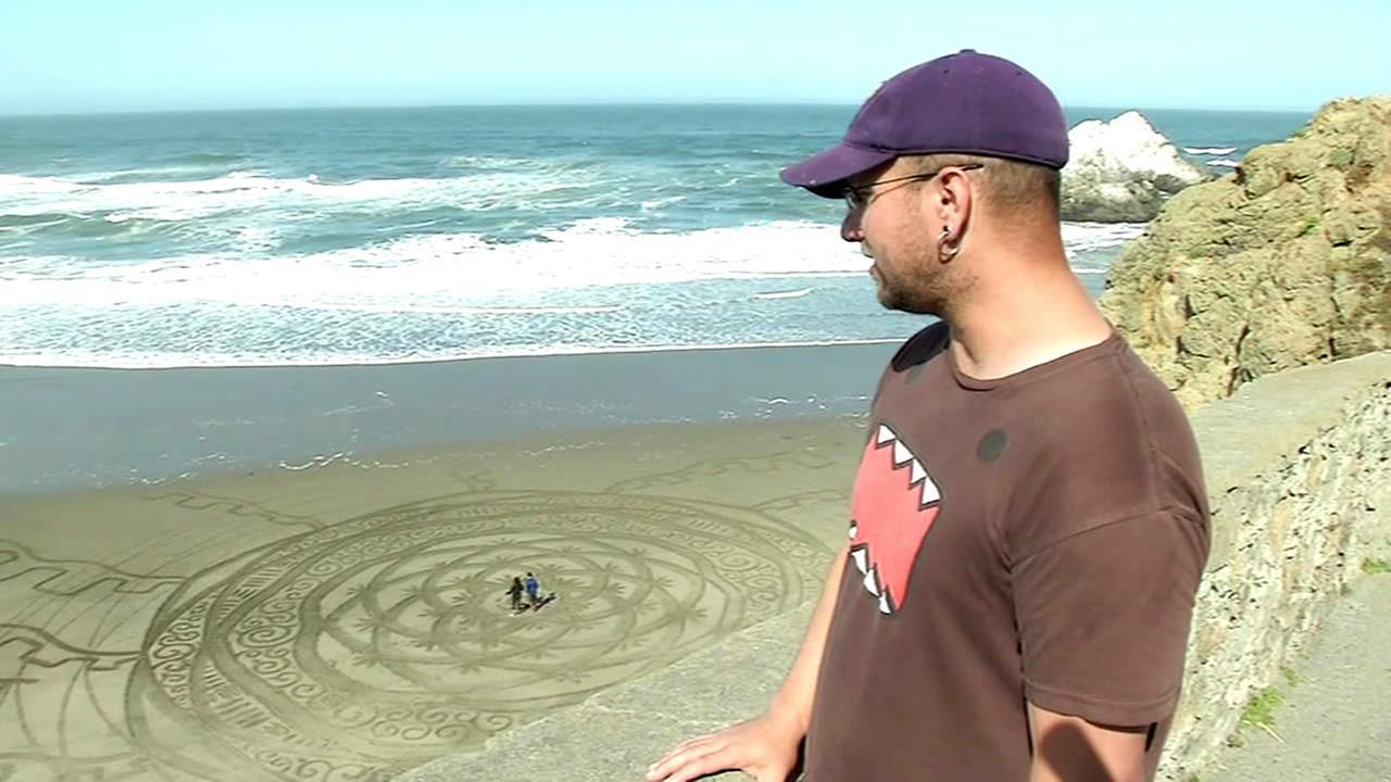 Brandon Anderton talks about an art display he created in the sand at San Franciscos Ocean Beach on May 7, 2015.