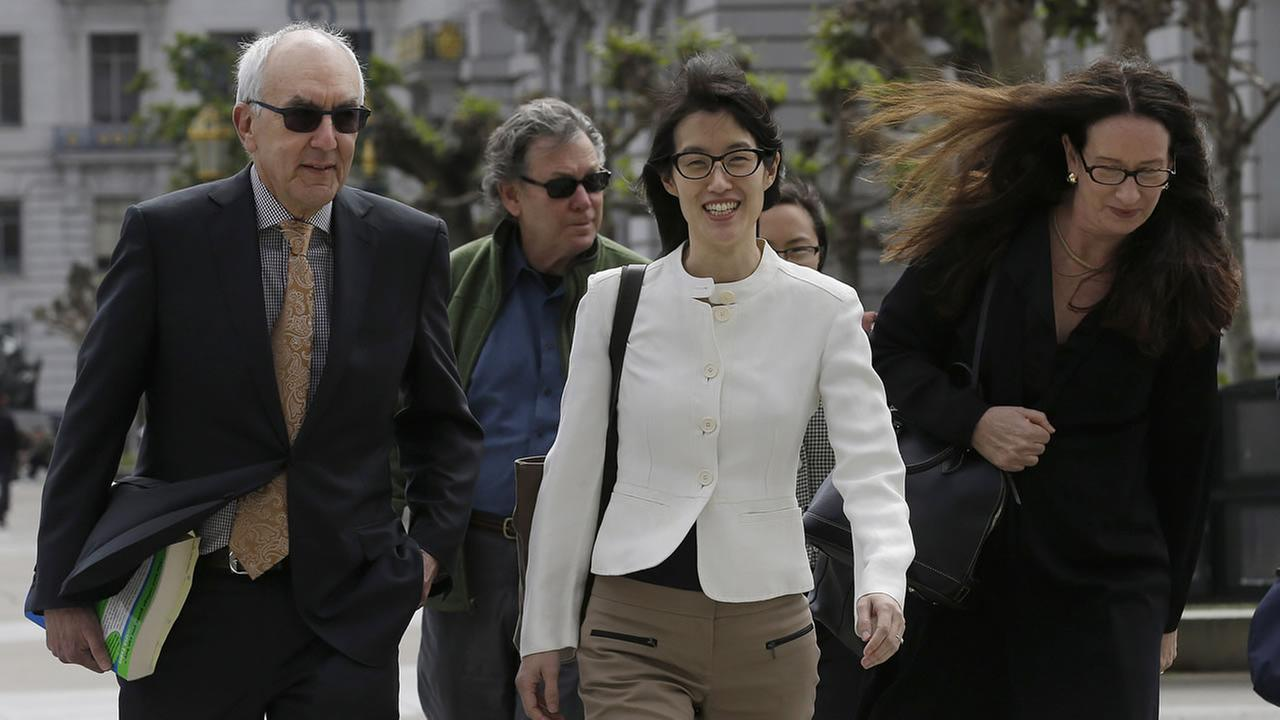 Ellen Pao, center, walks to Civic Center Courthouse
