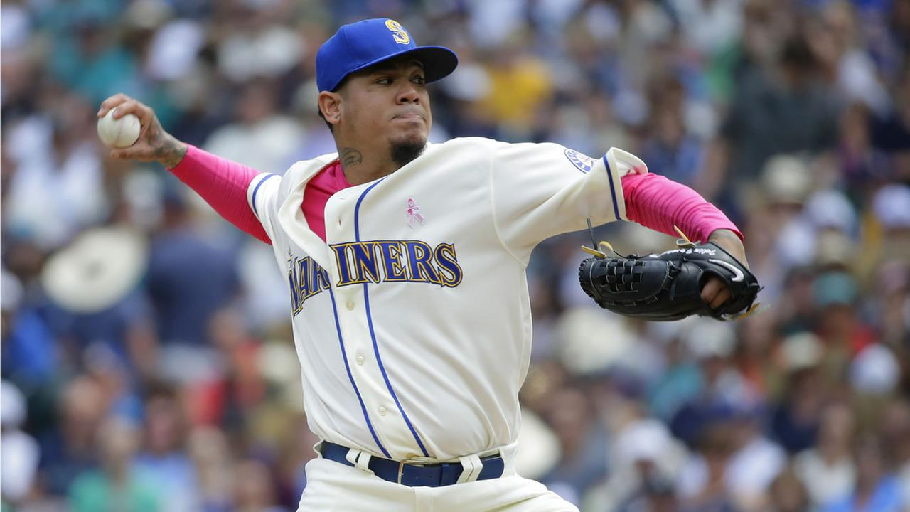 Seattle Mariners starting pitcher Felix Hernandez throws against the Oakland Athletics in a baseball game, Sunday, May 10, 2015 in Seattle. (AP Photo/Ted S. Warren)