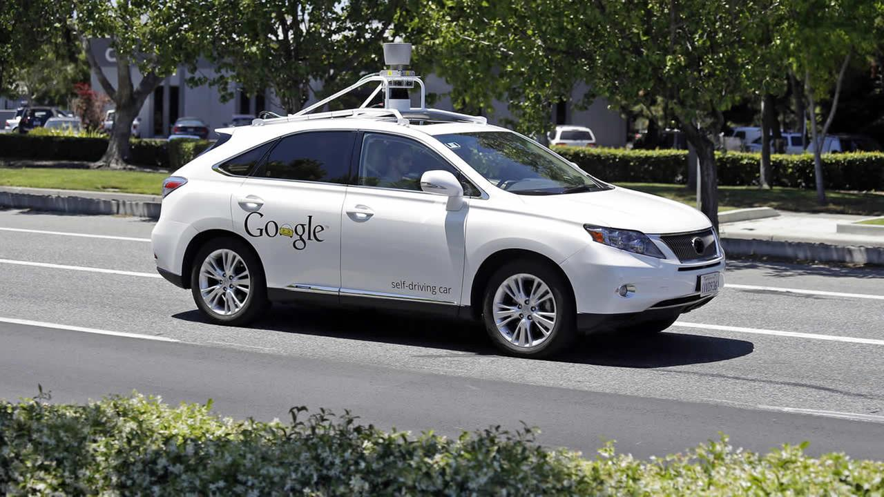 FILE - This May 13, 2014 file photo shows a Google self-driving Lexus at a Google event outside the Computer History Museum in Mountain View, Calif. (AP Photo/Eric Risberg, File)