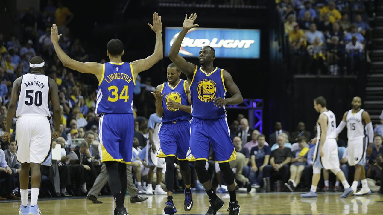 Golden State Warriors players celebrate in the second half of Game 4 of a second-round NBA basketball Western Conference playoff series against the Memphis Grizzlies.AP Photo/Mark Humphrey