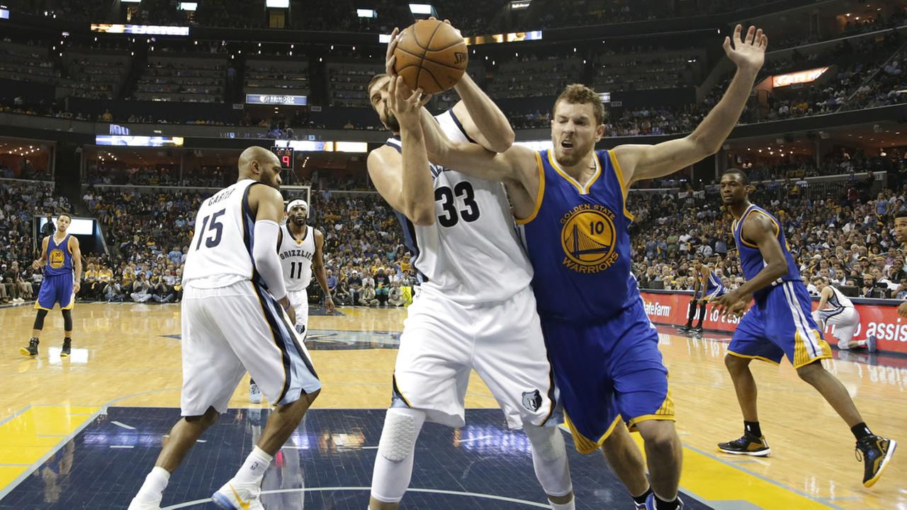 Memphis Grizzlies center Marc Gasol (33), of Spain, and Golden State Warriors David Lee (10) battle for a rebound in Game 4 of a second-round NBA Western Conference playoff game. AP Photo/Mark Humphrey
