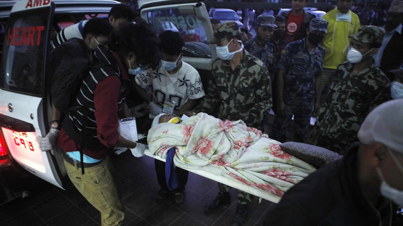 A Nepalese injured in Tuesdays earthquake is carried on a stretcher after she was brought from Charikot, Dolakha District to a hospital in Kathmandu, Nepal, Tuesday, May 12, 2015.AP Photo/Niranjan Shrestha
