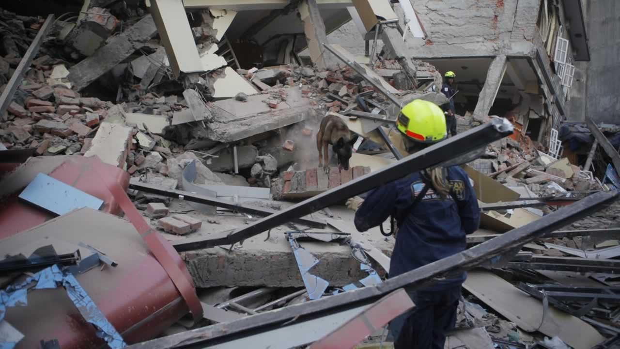 A rescue worker inspects the site of a building that collapsed in an earthquake in Kathmandu, Nepal, Tuesday, May 12, 2015.AP Photo/Niranjan Shrestha