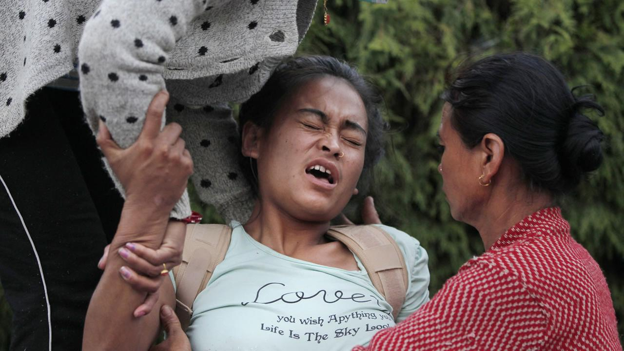 A Nepalese victim of Tuesdays earthquake tries to sit up with the help of family members at Teaching Hospital in Kathmandu, Nepal, Tuesday, May 12, 2015. AP Photo/Niranjan Shrestha